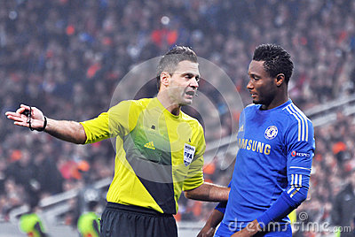 The referee talks with John Obi Mikel Editorial Photography