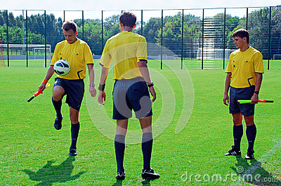 Referees play with ball Editorial Stock Photo