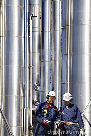 Refinery workers and pipelines