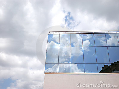 Reflected sky on building