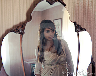 Reflection of Beautiful Young Woman in Mirror
