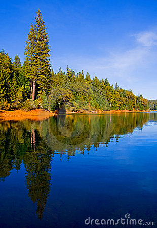 Reflection in clear blue lake
