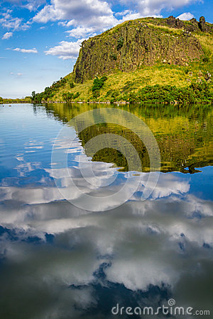 Reflection of clouds in a mountain lake