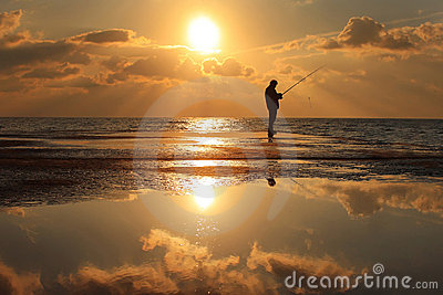 Reflection of a fisherman at dawn