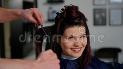 Reflection of hairdresser doing haircut for woman in hairdressing salon. Concept of fashion and beauty.  stock footage