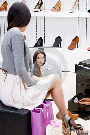 Free Reflection Of Woman Trying On High Heeled Shoes Royalty Free Stock Photography - 38843077