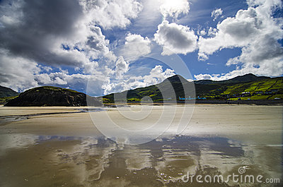 Reflection of the sky on the beach