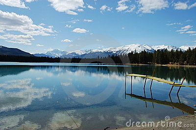 Reflection of sky on lake in Jasper