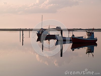 Reflection of a small dinghy dory boats