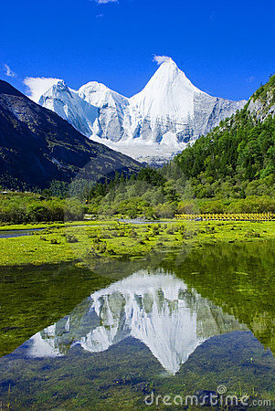 The reflection of snow mountain