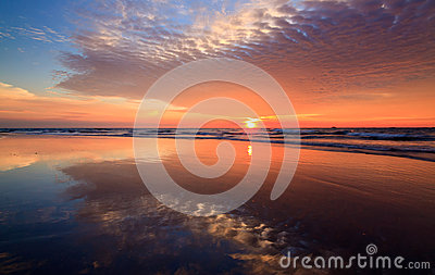 Reflection of sunset colors at a beach