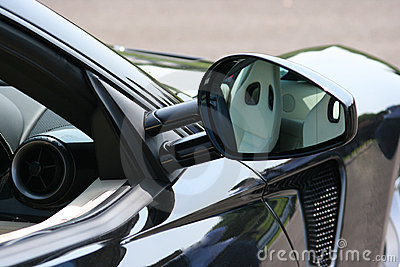 Reflection in supercar door mirror