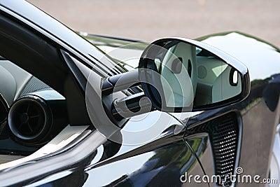 Reflection in supercar door mirror
