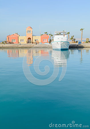 Free Reflections Of The Water On Boat Anchored At A Marina Stock Image - 68735051