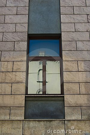 Reflective Window in a Old Office Stone Building