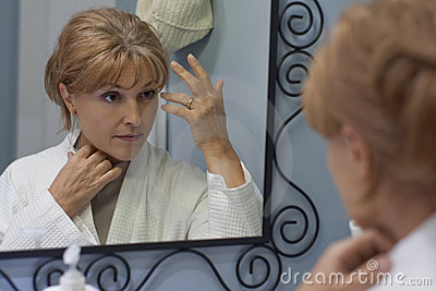 Reflexion of woman looking in mirror