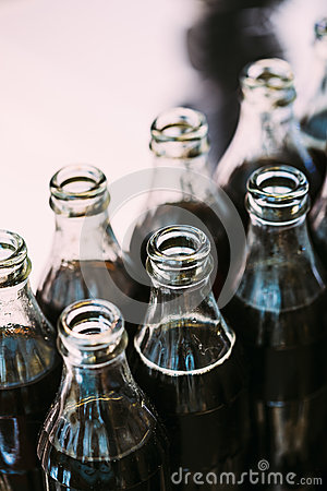 Free Refreshing Brown Soda In Bottles In Candy Bar On Table Royalty Free Stock Images - 68539979