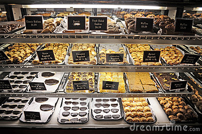 Cookies muffins danish and baklava on display in store refrigerated
