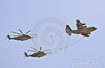 Refueling Plane and Helicopters Editorial Stock Photo