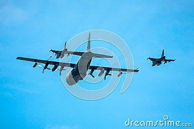 Refueling two jet fighters in-flight