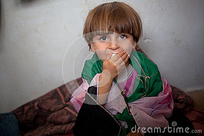 Refugee child wrapped in homemade Free Syrian flag, Atmeh, Syria. Editorial Image