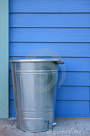 Refuse bin and blue wall