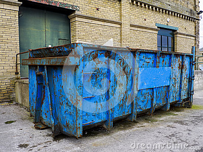 Refuse Skip in front of Brick Building