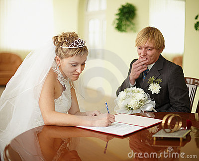 Registration of marriage. Groom in doubt.