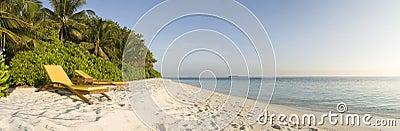 Relax chair on white sand beach Maldives