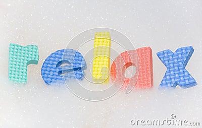 Relax Letters In Bubble Bath Foam Stock Photo