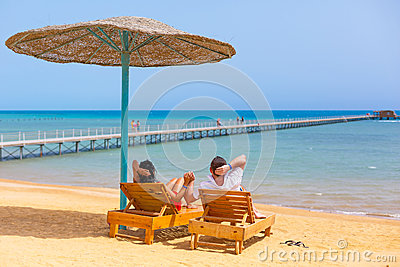 Relax of loving couple on the beach in Egypt