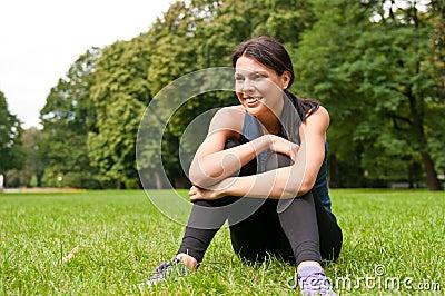 Relax - sportswoman sitting
