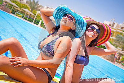 Relax of two tanned girls