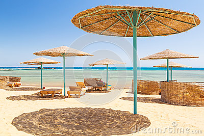 Relax under parasol on the beach of Red Sea