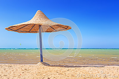 Relax under parasol on the beach