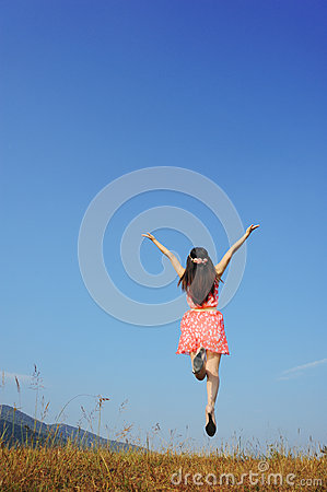 Relax Woman jumping with blue sky