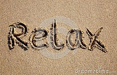 Relax, written on a beach.