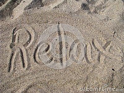 Relax written in sand