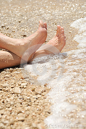 Free Relaxation On Beach, Detail Of Male Feet Stock Images - 27595254