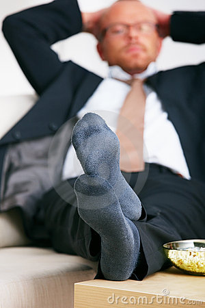 Relaxation - Relaxed business man lying on a sofa