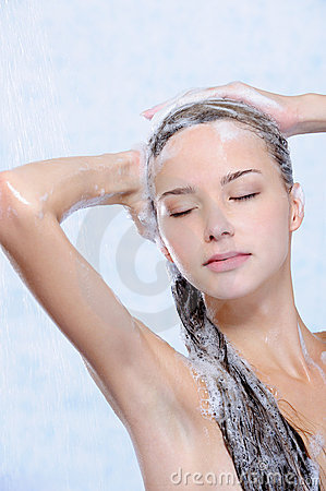 Relaxation of young woman taking shower