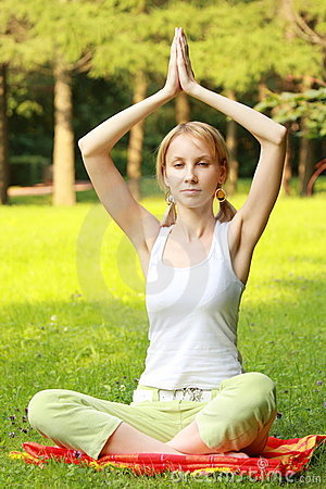 Relaxed blonde in yoga pose