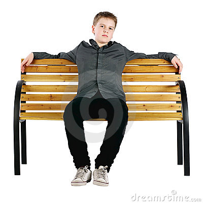 Relaxed boy sitting on bench