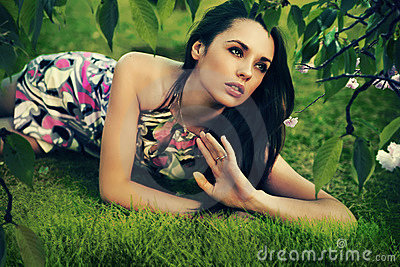 Relaxed brunette in garden