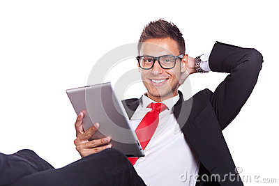 Relaxed business man using electronic pad tablet