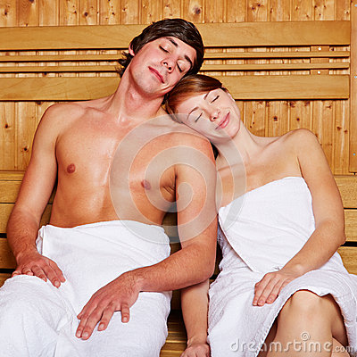 Relaxed couple in a sauna