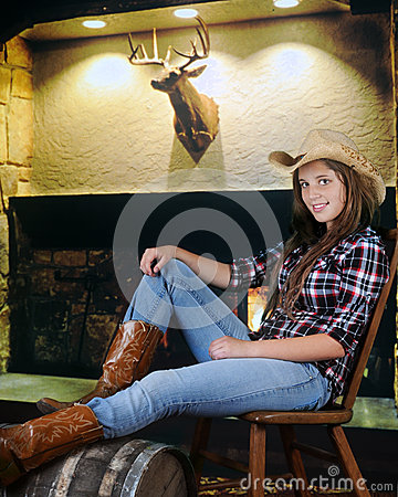 Free Relaxed Cowgirl Royalty Free Stock Photography - 45205387