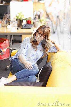 Relaxed female executive in office