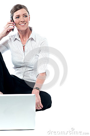 Relaxed female manager communicating