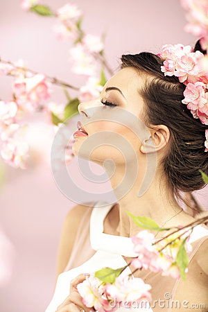 Relaxed girl smelling the spring flowers